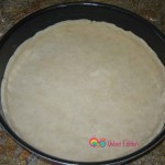 Cover the pan and create and edge on the sides of the pan by about 1/2 an inch.