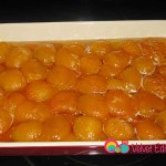 Repeat these steps with the rest of the apricots, layering and boiling them in batches. Add them to the apricots in the baking pan.