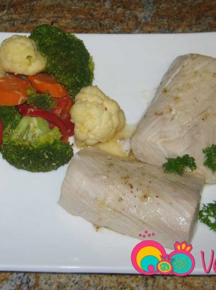 Drizzle lemon butter sauce over fish and serve with steamed vegetables.