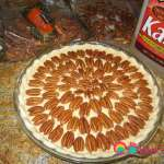 Arrange the pecans over the filling in a concentric pattern.