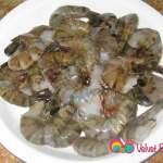 Wash and drain the prawns or shrimp.