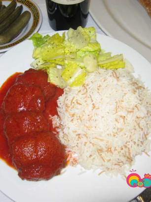 Beef patties in tomato sauce served with jasmine rice and a salad with lemon mint dressing.