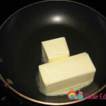 Place the unsalted butter into a saucepan.