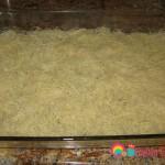 Spread half of the kataifi into a glass heatproof baking dish.