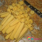 Cut the baby corn into 1/4 inch slices.