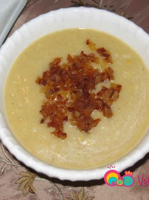 Pour the soup into a serving bowl and add some of the caramelized onions over the top.