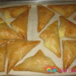 Bake till golden brown, about 25 to 30 minutes. Serve warm with syrup and ground pistachios.