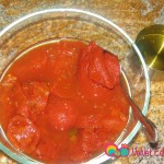 In another bowl add the canned tomatoes, tomato paste and water. Mix together till the paste has dissolved.