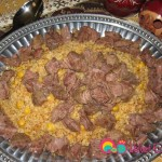 Place the bulgur pilaf and arrange the beef chunks over the top.