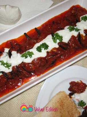 Spoon the garlic yogurt sauce over the top of the eggplants and garnish with chopped parsley if desired.
