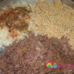 Add the meat to the yarma and the onions.